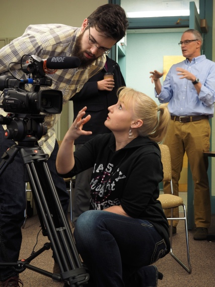 Emilie Johnson and graduate student Ted Phillips discuss camera shots while instructor Jeff Browne greets the subject of their documentary interview at the Armory on CU's main campus on Friday, January 23, 2015. (Photo/Roxann Elliott)