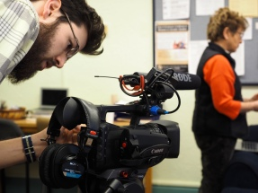 CU graduate student Ted Phillips adjusts a camera for an interview in the Armory on CU's main campus on Friday, January 23, 2015. (Photo/Roxann Elliott)